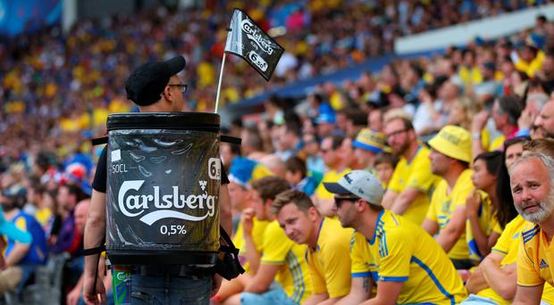 Carlsberg beer is sold to fans during the UEFA EURO 2016 Group E match between Italy and Sweden. Photo: Getty