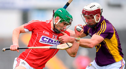 Cork's Alan Cadogan is determined to overcome a challenge from Wexford's James Breen. Photo by Stephen McCarthy/Sportsfile