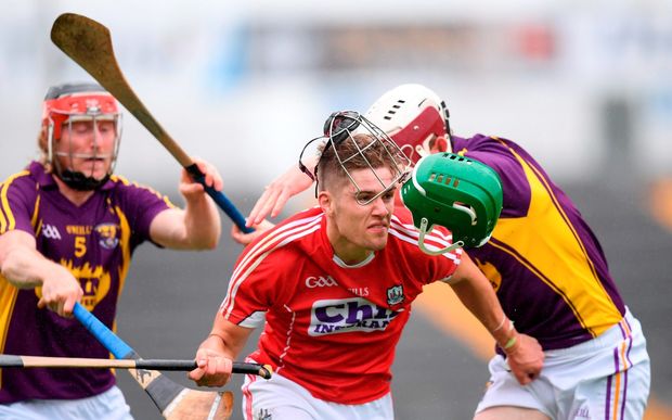 Cork's Alan Cadogan resists a strong challenge from Wexford's James Breen, right, and Diarmuid O'Keeffe. Photo by Stephen McCarthy/Sportsfile