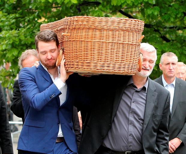 Anita Reeves' coffin is carried by her son Danny and husband Julian Erskine Photo: Gerry Mooney