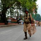 An Indian paramilitary trooper patrols during a curfew in Srinagar on July 10, 2016. / AFP PHOTO / TAUSEEF MUSTAFATAUSEEF MUSTAFA/AFP/Getty Images