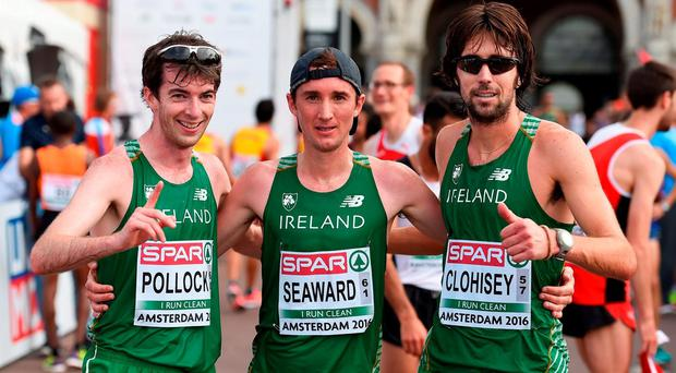 Ireland athletes, from left, Paul Pollock, Kevin Seaward and Mick Clohisey after finishing the Men's Half-Marathon day five of the 23rd European Athletics Championships at the Olympic Stadium in Amsterdam, Netherlands. Photo by Brendan Moran/Sportsfile