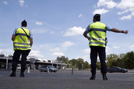 Police officers stand guard at the entrance of the A6 highway 50 kilometers south of Paris on July 8, 2016. / AFP / DOMINIQUE FAGET (Photo credit should read DOMINIQUE FAGET/AFP/Getty Images)