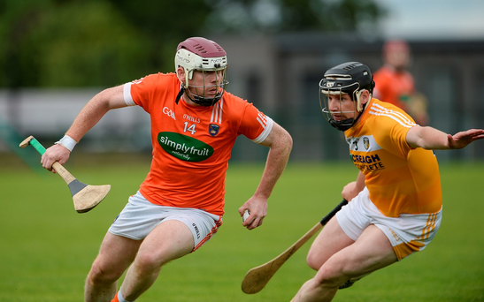 Eoin McGuinness of Armagh in action against Neal McAuley of Antrim during the Ulster GAA Hurling Senior Championship Final. Photo: Sportsfile