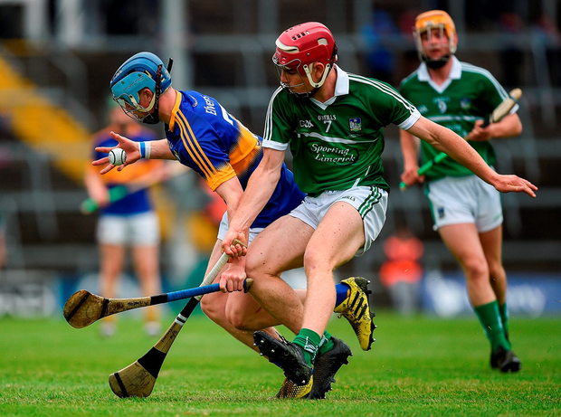 Tipperary's Jake Morris catches the ball, pursued by Limerick's Finn Hourigan. Photo by Ray McManus/Sportsfile