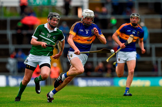 Tipperary's Ger Browne and Limerick's John Flynn compete for the ball. Photo by Ray McManus/Sportsfile
