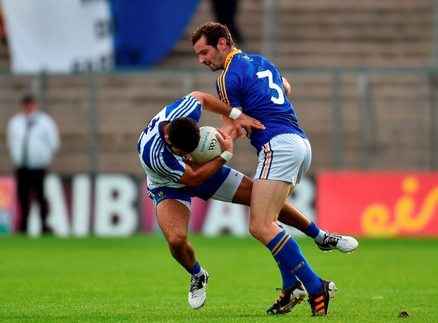Monaghan's Neil McAdam collides with Longford's Barry Gillian. Photo by Paul Mohan/Sportsfile