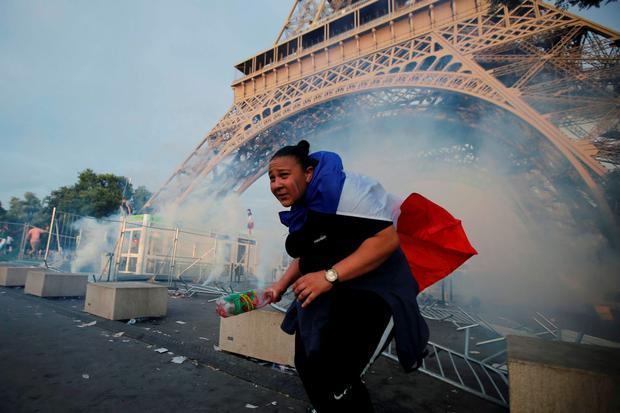 Tear gas floats in the air near the Eiffel Tower near the Paris fans zone before the start of the Portugal v France EURO 2016 final soccer match, at the Eiffel Tower in Paris REUTERS/Stephane Mahe