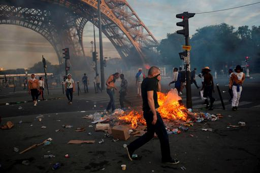 Garbage burns during clashes near the Paris fan zone at the Eiffel Tower during the Portugal v France EURO 2016 final soccer match, in Paris REUTERS/Stephane Mahe