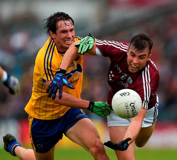 Galway's Paul Conroy is tackled by David Keenan . Photo by Ramsey Cardy/Sportsfile