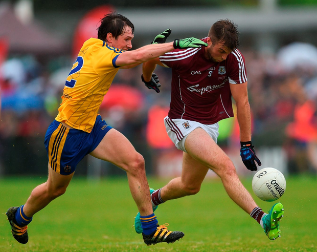 Galway's Paul Conroy is tackled by David Keenan. Photo by Ramsey Cardy/Sportsfile