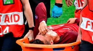 Ronaldo is carried off on a stretcher following a clash with Dimitri Payet. Photo: Getty Images