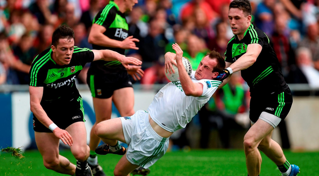 Fermanagh's Ruairí Corrigan is tackled by Patrick Durcan of Mayo at the weekend