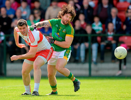 Meath's Mickey Burke in action against Derry's Mark Lynch in Owenbeg. Photo by Oliver McVeigh/Sportsfile