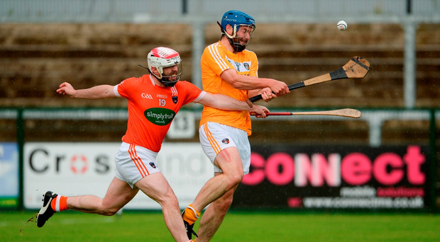 Antrim's John Dillon takes on Armagh's Fiachra Bradley in their Ulster SHC final. Photo by Oliver McVeigh/Sportsfile