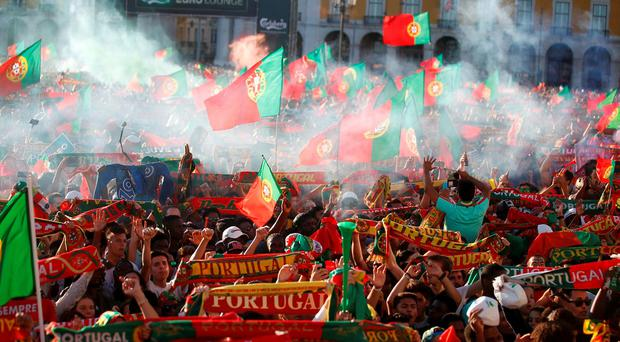 Portuguese supporters show their colours at a fans' zone in Lisbon after their team's victory. Photo: Rafael Marchante
