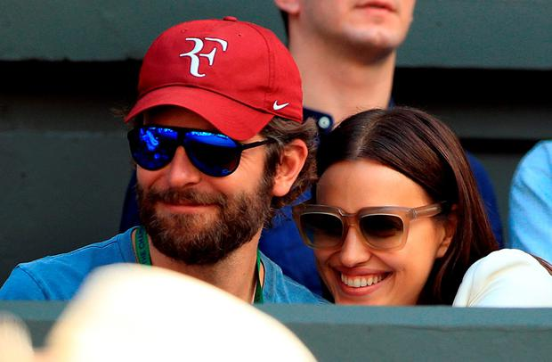 Bradley Cooper and Irina Shayk watches the action on centre court between Roger Federer and Marin Cilic on day nine of the Wimbledon Championships at the All England Lawn Tennis and Croquet Club, Wimbledon