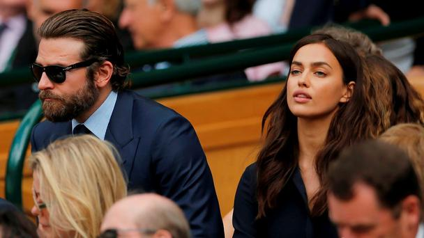 Actor Bradley Cooper and his girlfriend model Irina Shayk in the royal box on centre court at Wimbledon