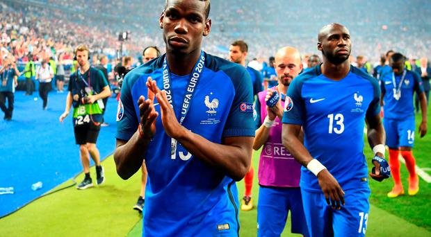 France's midfielder Paul Pogba acknowledges the fans after France lost to Portugal