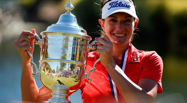 Brittany Lang holds the trophy after winning the US Open