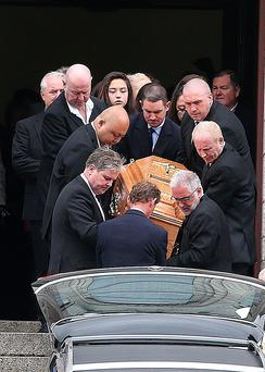The coffin is carried from the Church of the Precious Blood in Cabra after the funeral of David Douglas.