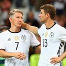 Bastian Schweinsteiger and Thomas Mueller of Germany console each other after defeat in in the semi-final