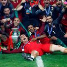 Portugal's Cristiano Ronaldo celebrates with team mates and the trophy after winning Euro 2016