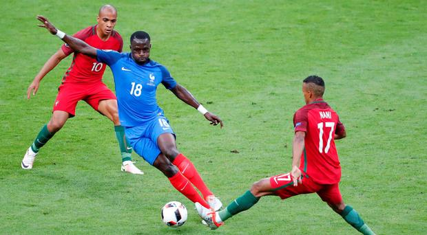 Portugal's Nani and France's Moussa Sissoko in action