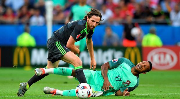 Joe Allen of Wales battles for the ball with Nani of Portugal
