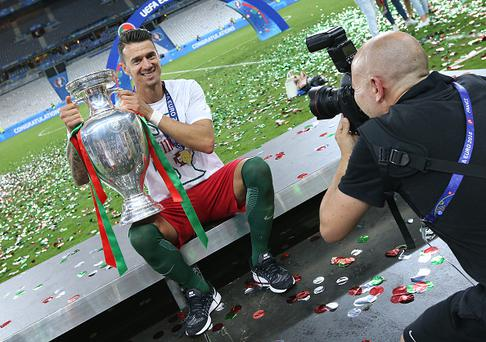 PARIS, FRANCE - JULY 10: Jose Fonte of Portugal poses with the trophy following the UEFA Euro 2016 final match between Portugal and France at Stade de France on July 10, 2016 in Saint-Denis near Paris, France. (Photo by Jean Catuffe/Getty Images)