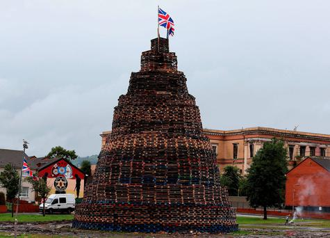A bonfire in Belfast's Lower Shankill Road ready for the '12th' celebrations. Photo: Brian Lawless/PA Wire