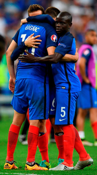 N'Golo Kante embraces his team-mates after their Euro 2016 defeat to Portugal in which he was an unused substitute Photo: PATRIK STOLLARZ / AFP / Getty Images