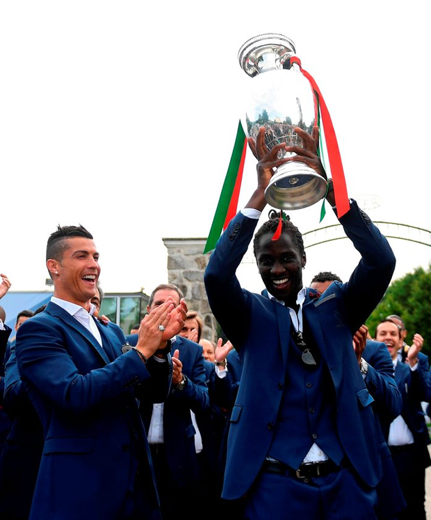 Match-winner Eder holds aloft the Henri Delaunay trophy Photo: FRANCISCO LEONG / AFP / Getty Images