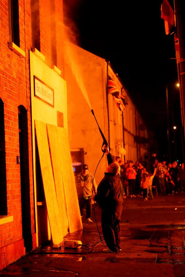 A bonfire is lit on the Shankill Road in Belfast on the