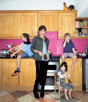 'My kids would probably rather have the money saved on fees handed to them as a lump sum, down the line, when they want to buy a house'. Emily Hourican with her children, Malachy, Davy and Bee. Portrait: Kip Carroll.