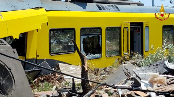 A damaged passenger train is seen after a collision with another in the middle of an olive grove in the southern village of Corato, near Bari, Italy, in this handout picture released by Italian Firefighters July 12, 2016. Italian Firefighters/handout via Reuters