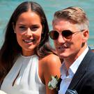 Tennis player Ana Ivanovic and Germany soccer player Bastian Schweinsteiger sit in the back of a boat during their wedding, in Venice back in July. Picture: AP Photo/Luigi Costantini