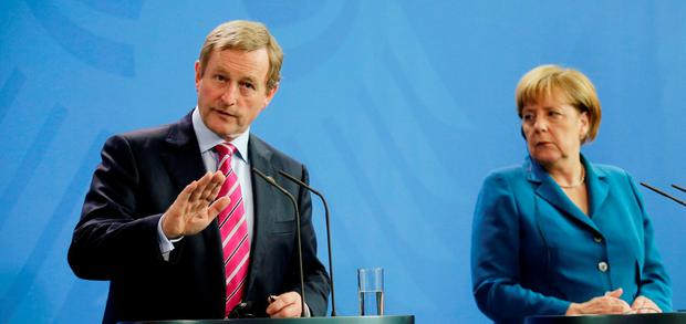 German Chancellor Angela Merkel (right) and Enda Kenny attend a news conference at the chancellery in Berlin. Reuters/Hannibal Hanschke