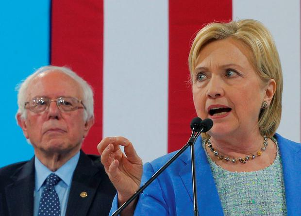 Democratic US presidential candidate Hillary Clinton addresses a campaign rally where Democratic candidate Sen. Bernie Sanders (L) endorsed Clinton in Portsmouth, New Hampshire,US. Photo: REUTERS/Brian Snyder