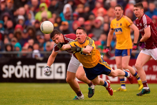Roscommon's Ciaran Murtagh comes under pressure from Galway's Eoghan Kerin during the drawn Connacht SFC final in Pearse Stadium. Photo: Sportsfile