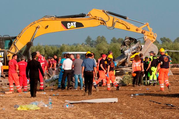 Rescuers work after a head-on collision between two trains, near Corato, in the southern Italian region of Puglia. MARIO LAPORTA/AFP/Getty Images