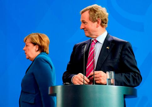 German Chancellor Angela Merkel and Taoiseach Enda Kenny finish their joint news conference at the chancellery in Berlin. AFP/Getty Images