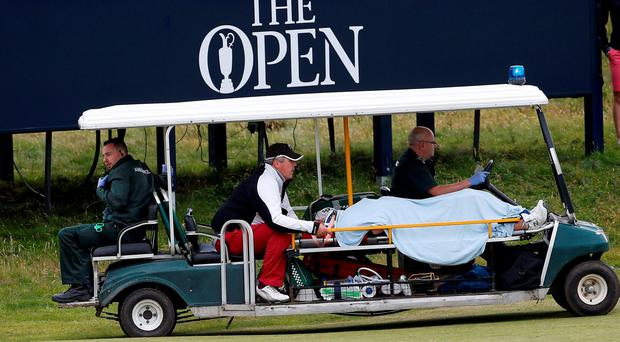 A caddie was taken to hospital after being hit on the head by a stray shot from former world No 1 Vijay Singh at Troon. Photo: Reuters