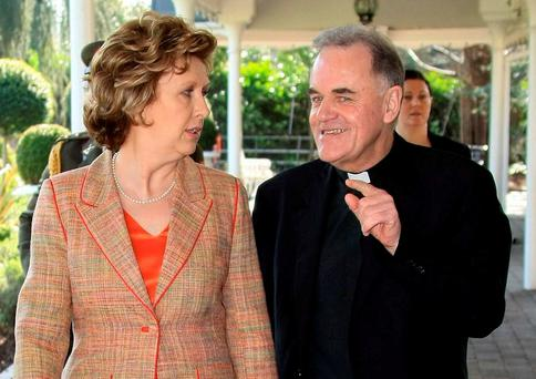 Fr Aidan Troy with the then president Mary McAleese at the Console National Conference in 2009. Photo: Collins