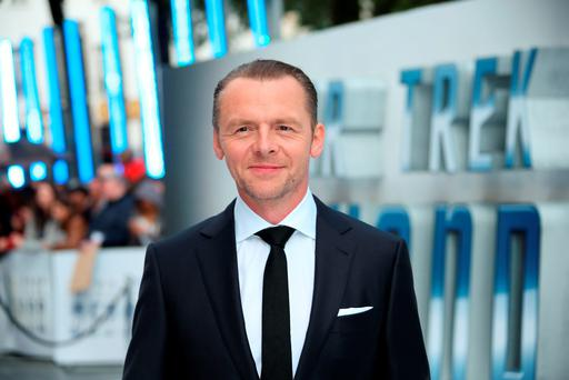 Actor Simon Pegg poses for photographers upon arrival at the premiere of the film 'Star Trek Beyond' in London. (Photo by Joel Ryan/Invision/AP)