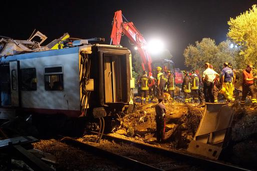 Rescuers work after a head-on collision between two trains, near Corato, in the southern Italian region of Puglia. Photo: AFP/Getty Images