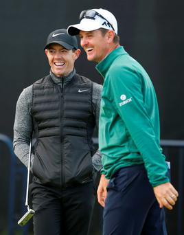 Northern Ireland's Rory McIlroy speaks with England's Justin Rose after a practice round at Royal Troon yesterday