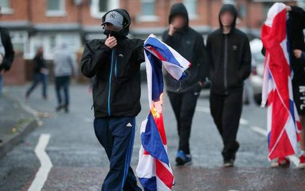 Republican youths attempt to burn a Union flag