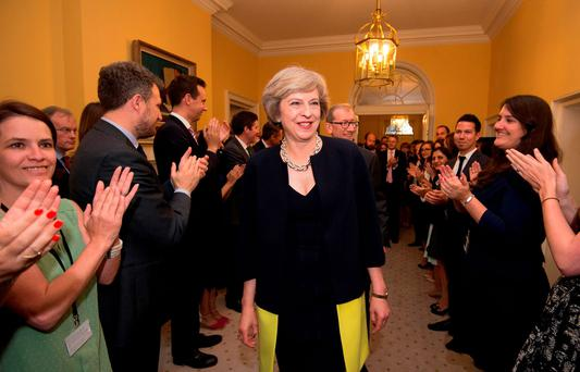 Staff clap as new Prime Minister Theresa May walks into 10 Downing Street, London, after meeting Queen Elizabeth II and accepting her invitation to become Prime Minister and form a new government Credit: Stefan Rousseau/PA Wire