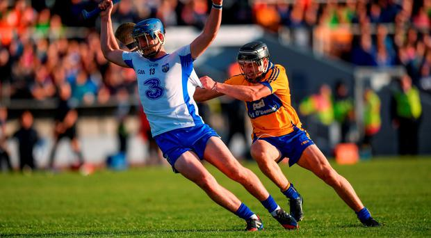 Waterford's Patrick Curran attempts to escape the clutches of Clare's Rory Hayes during their Bord Gáis Energy Munster U21 semi-final. Photo: Sportsfile